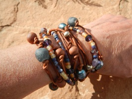 http://www.amazon.com/handmade/Boho-Wrap-Bracelet-Francesca Triple wrap bracelet….One of a Kind Natural (will get darker with time) Napa leather braided, multi cord bracelet. A unique combination of High-fired stoneware,Recycled glass,fresh water pearl and semi-precious stone beads combine to make this 3x wrap bracelet. It is adorned with a magnetic clasp that makes it very easy to put on by yourself.Can easily double as a very cool necklace! PLEASE SPECIFY SIZE (sm22″ 6″wrist med23″ 7″wrist lg24″ 8″ wrist Thank you